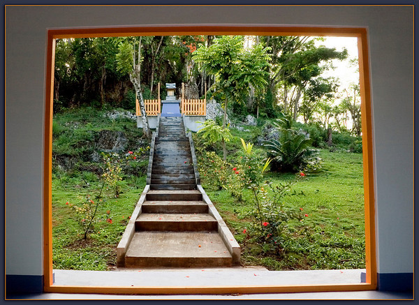 Sugar King Park..............Saipan<br /> Steps up to a little shrine. Beyond this is a hill with winding stone steps which lead to a wooden pagoda.