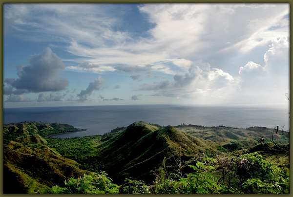 Cetti Bay, Guam<br /> <br /> Late afternoon sun highlights the verdant landscape of Cetti Bay.