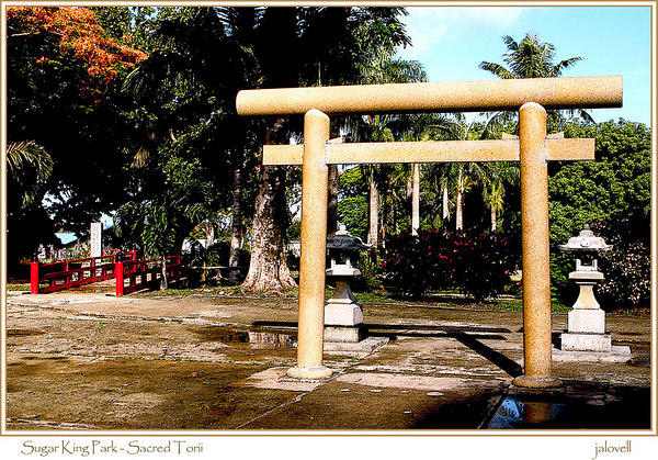 "Sugar King Park - Saipan<br /> <br /> The Japanese Shinto Shrine within Sugar King Park features the most enduring symbol of Shinto architecture-the entrance gate or torii.  Shinto means ""way of the gods or spirits."" The torii is a sacred gateway to the home of the spirits  and serves as the demark between the finite earthly world and the sacred world of the infinite.  Torii means ""bird"" or ""perch""  and is designed for birds to nest, traditionally constructed of two  columns with two cross beams. In Shinto birds are considered messengers of the gods."