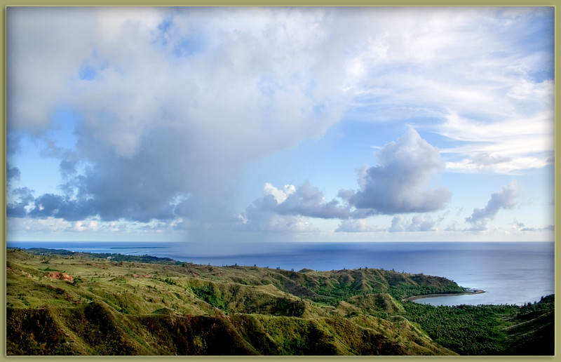 Rain Upon the Sea..................................Cetti Bay, Guam<br /> <br /> A column of rain moves along the shoreline beyond velvet hills at  Cetti Bay.