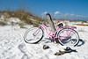 Pink bike rests on the beaches of the Gulf National Seashore