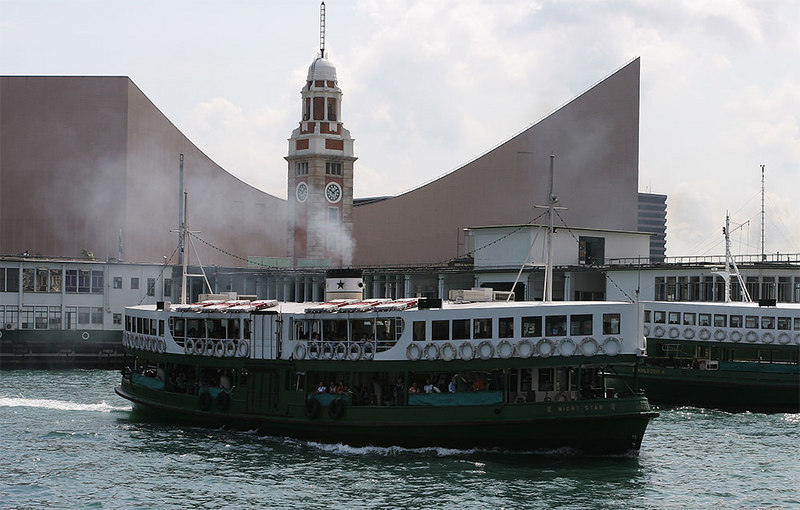 "One of the Star ferries departs Kowloon.  ""The Dark Side"". The cultural centre behind."