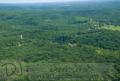 Aerial view of Ha Ha Tonka showing the castle and water tower.   Between them you can see a glimpse of the stables.