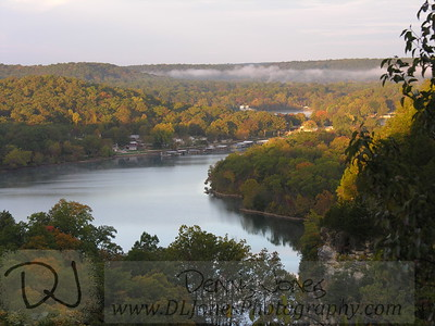Early morning fog lifts from the Lake of the Ozarks.  This view is from the castle at Ha Ha Tonka State Park.