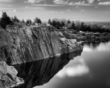 3 December 2011.  Halibut Point State Park.  Babson Farm quarry pond and Atlantic Ocean in background.  Photo taken with Nikon D90 and Nikkor 24-70 mm with yellow/orange (040M) filter and circular polarizer.  Processed with Photomatix Pro 4.1, Nik Silver Efex Pro 2, and Adobe Photoshop CS5.