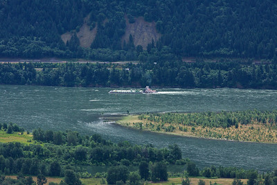A tug pushes a barge up the Columbia River.