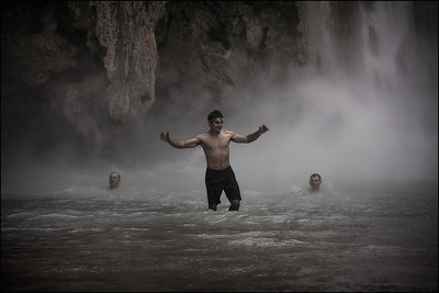 Cooling off in the mist from the Mooney Falls. Land of Supai Nation in the United States, Arizona.