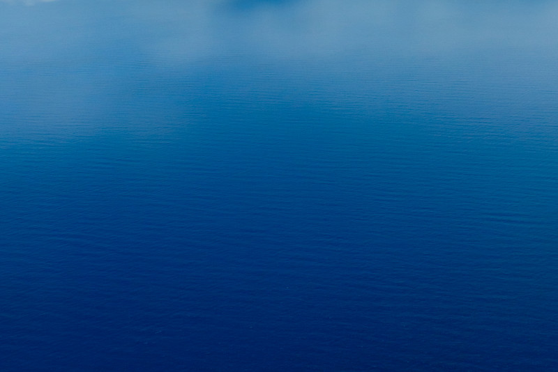 """Blue Ocean"" I thought I would see what folks thought of this and the other ""Clouds over the Blue Ocean"" image! I shot these from the airplane coming into the Big Island in Hawaii and just love the blue tones of the ocean below with nice definition of clouds (remember, I like clouds!) This image is quite minimalist and might be considered TOO artsy! Let me know what you think!"