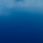 """""""Blue Ocean"""" I thought I would see what folks thought of this and the other """"Clouds over the Blue Ocean"""" image! I shot these from the airplane coming into the Big Island in Hawaii and just love the blue tones of the ocean below with nice definition of clouds (remember, I like clouds!) This image is quite minimalist and might be considered TOO artsy! Let me know what you think!"""