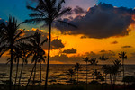 """Kauai Sunset"" Nothing better than a sunset in Kauai sitting on a beach with palm trees all around! Nice clouds and the glow of the sun poking through. The silhouette of the palms showing through. Who wants to go to Kauai.com and Stay in Kauai ?! I am ready to go!<br /> Copyright John Harrison Photography — at Kauai, Hawaii."