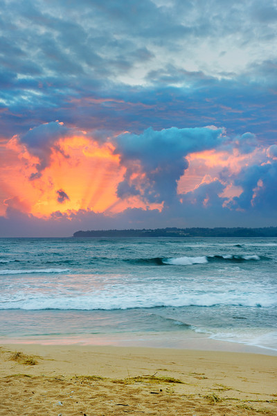 """""""Kauai Sunrise""""  Waking up on a beach in Hawaii is fantastic any day of the week, but to be in Kauai and have an incredible sunrise just tops it off!  The sand in your toes and amazing sunlight breaking through the clouds with colors that just make you smile.  That is the way to start the day off!  Next best thing... having this picture to take you away to where you could be!"""