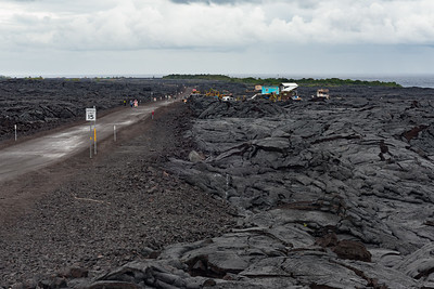 "There was a four-mile road across an older lava flow to get to the viewing area. We got a ""shuttle"" for the first two miles, and bikes for the last two miles. Those are permanent residences, built on the barren lava rock."