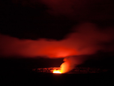 The fumes from Halema'uma'u Crater inside the Kilauea Caldera are lit up at night by the molten lava. Viewed from the Jagger Museum  in Hawai'i Volcanoes National Park, Hawaii.