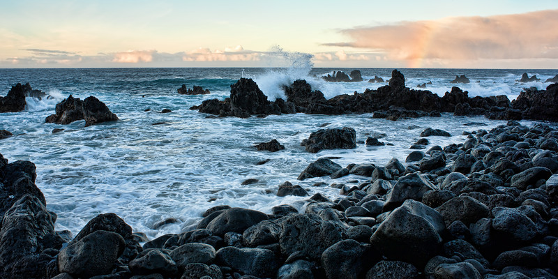 Lapahoehoe Rainbow<br /> <br /> The tide violently crashes over the jagged lava rocks, as the last rays of sunlight illuminate a timid rainbow at Lapahoehoe Beach Park, Big Island, Hawai'i, USA
