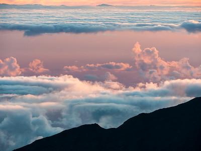 Sunrise at Pu'u'ula'ula Summit and Haleakala Observatories in Haleakala National Park, Maui, HI.