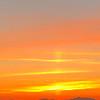 Orange Sunrise haze over the clouds coming into Seatle