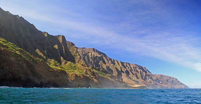 The western Na Pali Coast of Kauai as seen from a tour boat.