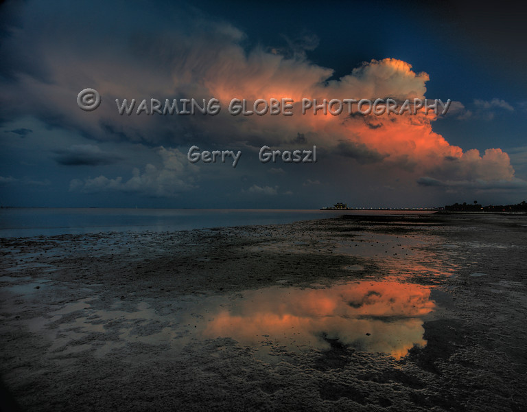 Low tide sunset and summer Thunder storm over the St Pete Pier