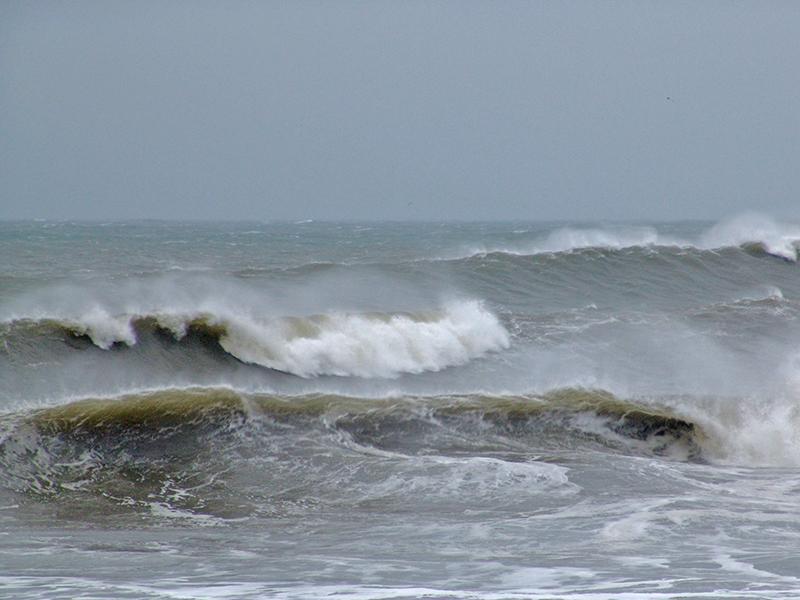 More crashing waves at Rockaway Beach.