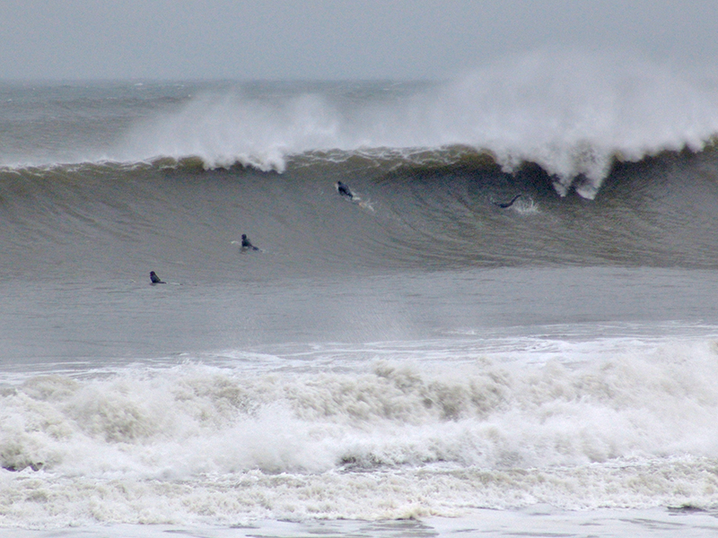 Here there are four surfer dudes. Guess they didn't like this wave either. Rockaway Beach.