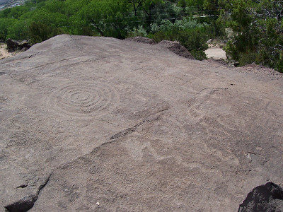 Detail of the eleborate old petroglyphs. The etchings  are so old they are nearly the same color as the surrounding stone and very hard to see now.