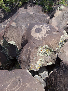 This shield looks like it might have been incomplete for some reason. Crosses appear frequently near native petroglyphs... supposedly an effort by Spanish missionaries to counteract the power of what they believed were evil symbols.