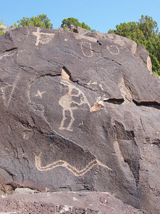 A Kokopelli figure playing the flute and a snake.