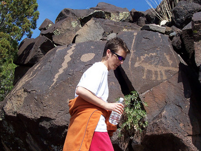 Caroline checks out the snake and lizard petroglyphs.