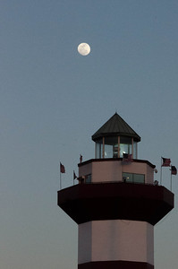 Moon over lighthouse