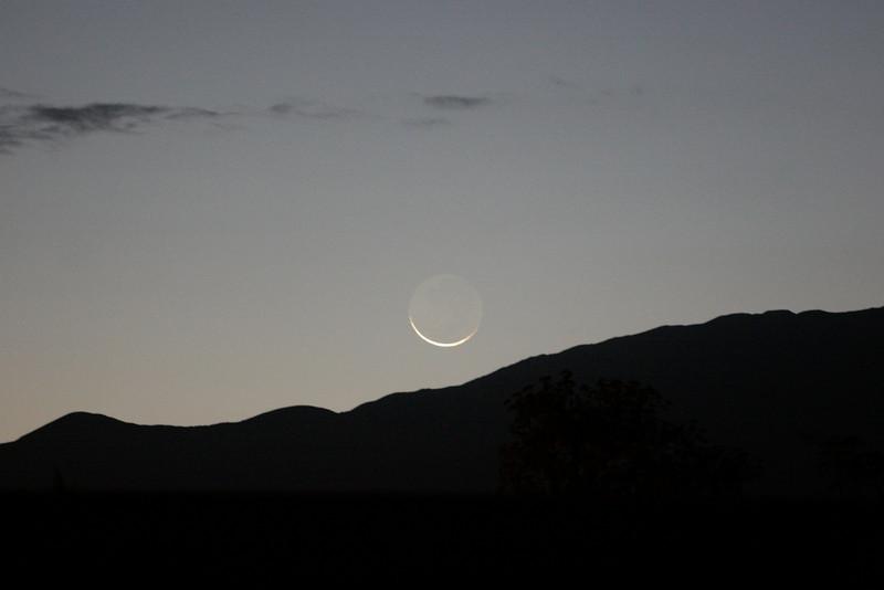 Hilo Moon setting over Mauna Kea.