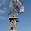 A beautiful wooden windmill fully restored and on display at the Lubbock Windmill Museum.