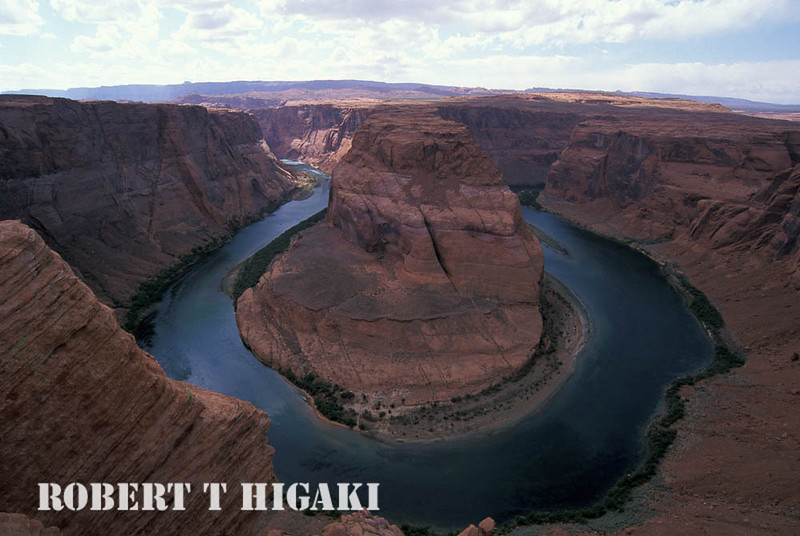 Horseshoe Bend of the Colorado River, Page AZ  You cannot tell from this picture but it was very scary to do. In order to get this shot, you have to use a wide angle lens. The problem with wide angle is you get too much foreground( rocks in this case). So, I inched myself toward the edge to get the picture. Only one problem: it is about 1500 feet sheer drop to the bottom. Another issue is the rock you are sitting on- its actually an outcropping. You are not on solid rock. One day, that outcropping will break off and take some unlucky photographer(s) with it.