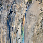 "Rainbows on Horsetail Falls in Yosemite National Park.  This ephemeral waterfall off of El Capitan, it is just a wisp of a waterfall.  This is a different look at this ephemeral waterfall, Horsetail Falls.  With just a trickle of water coming over it, it sparkled in the Sun.  Yosemite National Park, Aperture Nature Photography Workshop contest.  My ""Nature's Firefalls"" is the version of this that looks like lava is pouring down from the falls.  It can be seen here:  <a href=""http://www.jharrisonphoto.com/gallery/2747559_ghkMc"">http://www.jharrisonphoto.com/gallery/2747559_ghkMc</a>"