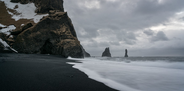 Black Sand Beach and Reynisdrangar (sea stacks).  Vík is on the other side of the basalt cliffs.