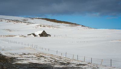 Most private farm buildings look like this -- small, low-roofed and tucked under hills/mountains.  Almost all the cattle and sheep were penned inside for the winter.
