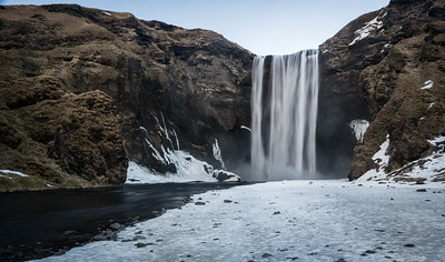 The first shoot at Skogafoss was on a dreary day with driving mist and treacherous ice underfoot