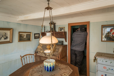 "This ""parlor"" dates from 1896.  Friend Jim is shooting into the adjoining room.  Such a low ceiling!  Skogafoss waterfall in photo at left."