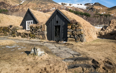 "Turf farmhouses.  ""The parlour dates from 1896, bedroom from 1838, pantry from about 1850, kitchen from about 1880, baðstofa (communal room where the household slept, ate and worked) from 1895."""