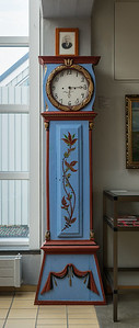 Grandfather clock (1849) with maker's portrait above it