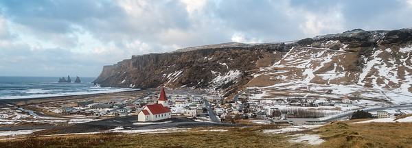 Vík, looking west/southwest.  The old ring road is visible zig-zagging up the mountain.