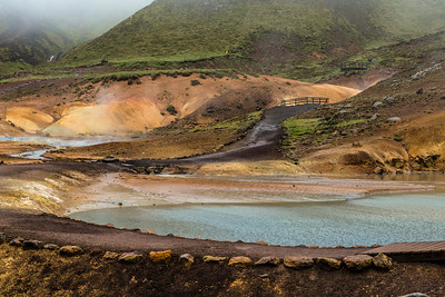 Colored soil, lake, trail and observation deck in Krýsuvík Iceland