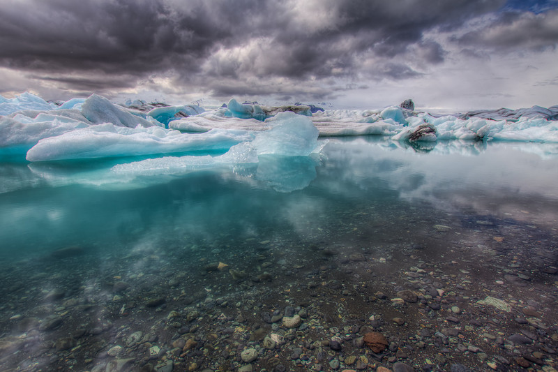 "Jökulsárlón (literally ""glacial river lagoon"") - The blue color of the icebergs seem to color the water in the lagoon."