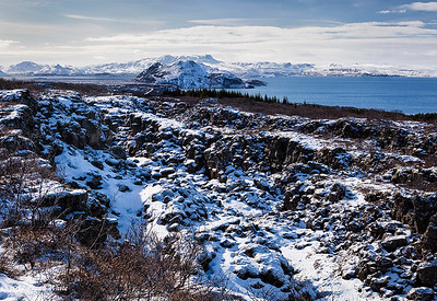 Along a ridge in Þingvellir National Park, with the Þingvallavatn lake in the background.