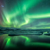 Northern light, aurora borealis, dancing across the sky above the glacier lagoon of Jokulsarlon, south Iceland.