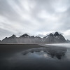 This is Mt Vestrahorn in the south east of Iceland. The clouds and tones help to make this a moody image for me. The foreground reflections add just a spark of brilliance to complete the composition.