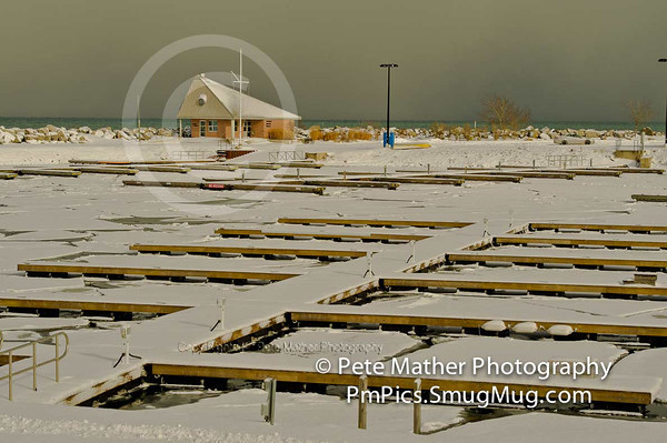 """""""No Docking"""" A wintery day with empty docks frozen in, at the Thornbury Harbour."""