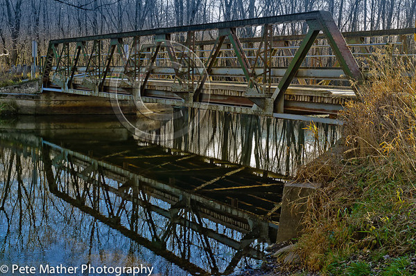 The Epping Bridge. This a steel bridge that crosses over the meandering Beaver River in the Beaver Valley between Heathcote and Kimberly Ontario. This area is a large biosphere of nature.