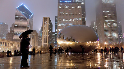 Man with Umbrella at Cloud Gate on a Rainy Night - New Years Eve, Millennium Park, Chicago 2011/12