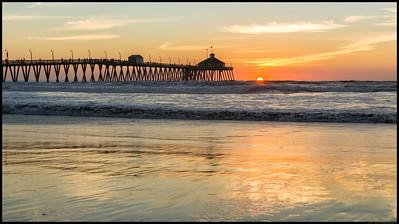 Imperial Beach pier as the sun drops below the horizon.