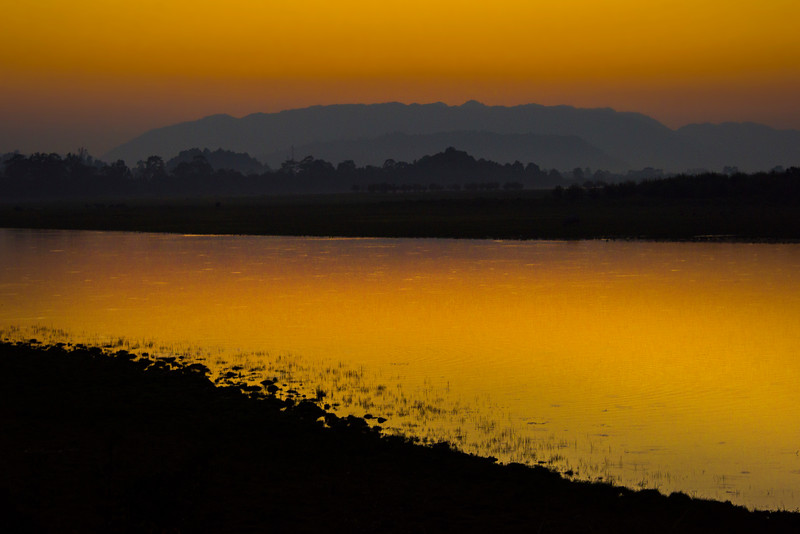 Sunset Red Silhouette Along River Kaziranga National Park, Assam, North-Eastern India